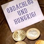 Obdachlos und hungrig Münzen