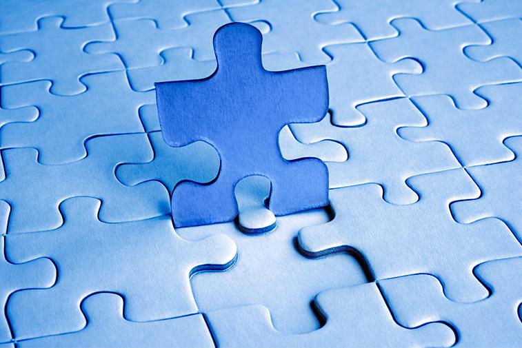 Aufgestelltes Puzzleteil blau