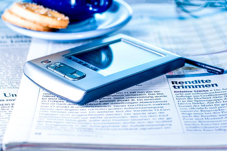 Börsen-Zeitung Tablet PC Kaffeetasse Rendite